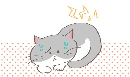 元気がなくて顔をしかめている猫のイラスト